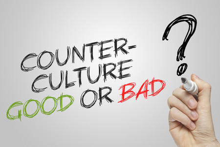 counterculture: Hand writing counterculture good or bad on grey background