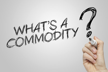 commodity: Hand writing commodity on grey background