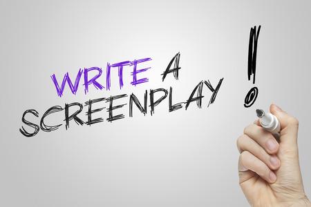screenplay: Hand writing write a screenplay on grey background