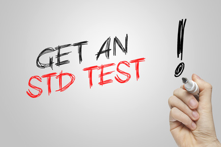 Hand writing get an std test on grey background Imagens - 39846515