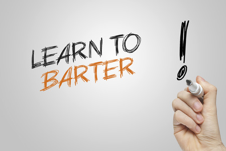 barter: Hand writing learn to barter on grey background