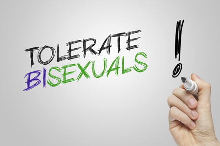 tolerate: Hand writing tolerate bisexuals on grey background