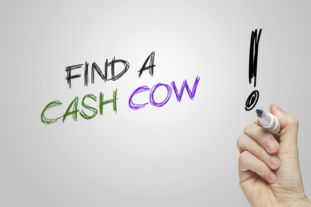 cash cow: Hand writing find a cash cow on grey background Stock Photo