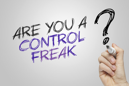 Hand writing are you a control freak on grey background