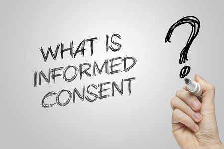 consent: Hand writing what is informed consent on grey background