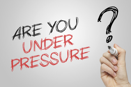 under pressure: Hand writing under pressure on grey background