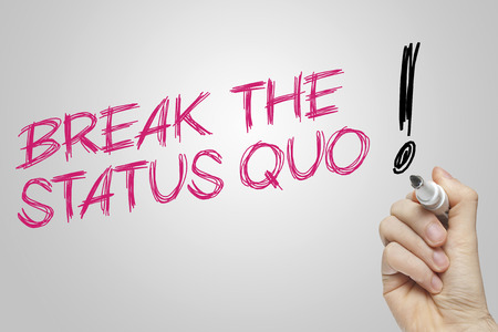 quo: Hand writing break the status quo on grey background