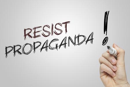 hand writing: Hand writing resist propaganda on grey background