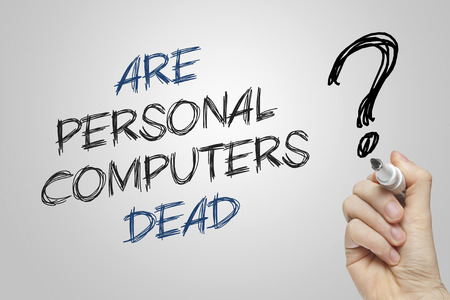personal computers: Hand writing are personal computers dead on grey background
