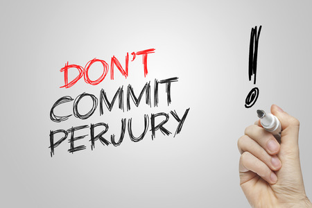 commit: Hand writing dont commit perjury on grey background