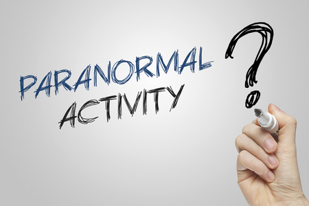 paranormal: Hand writing paranormal activity on grey background