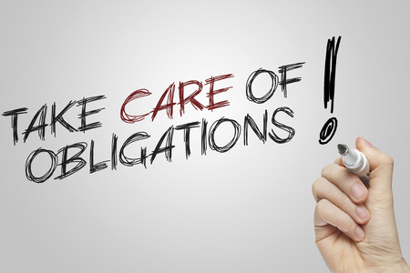 obligations: Hand writing take care of obligations on grey background