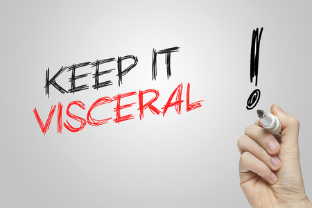 visceral: Hand writing keep it visceral on grey background
