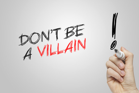 villain: Hand writing dont be a villain on grey background