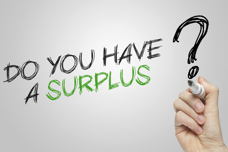 surplus: Hand writing do you have a surplus on grey background