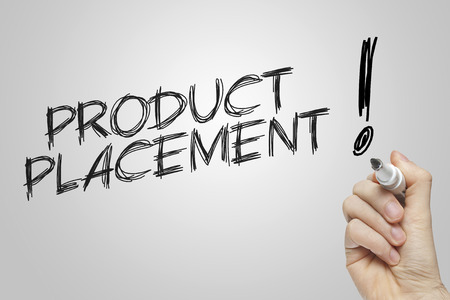placement: Hand writing product placement on grey background Stock Photo