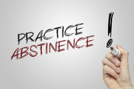 abstinence: Hand writing practice abstinence on grey background Stock Photo