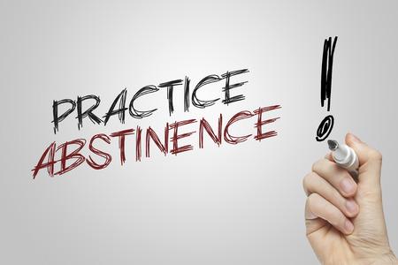 abstinence: Pratica di scrittura a mano astinenza su sfondo grigio