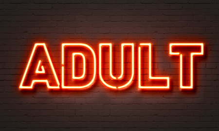 prostitution: Adult neon sign on brick wall background