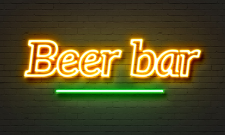Beer bar neon sign on brick wall background photo
