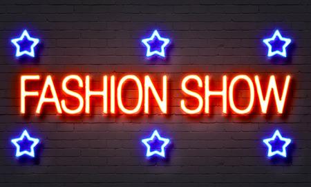 craze: Fashion show neon sign on brick wall background Stock Photo