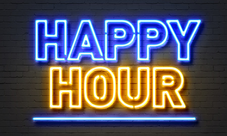 blue hour: Happy hour neon sign on brick wall background Stock Photo
