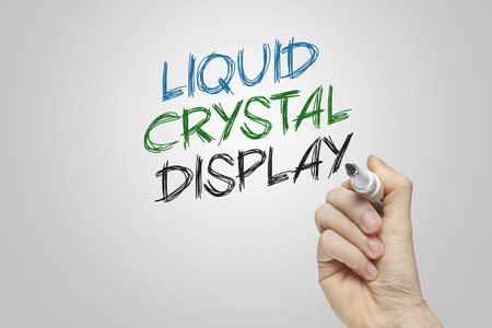 liquid crystal: Hand writing liquid crystal display on grey background