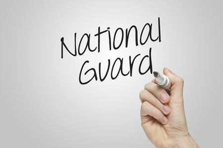 hand guard: Hand writing national guard on grey background