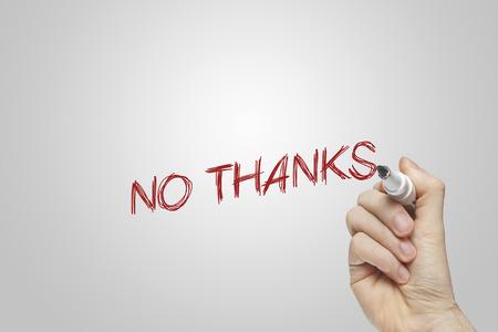 Hand writing no thanks on grey background Stock Photo