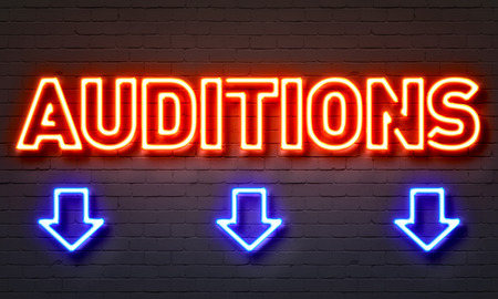 Auditions neon sign on brick wall background