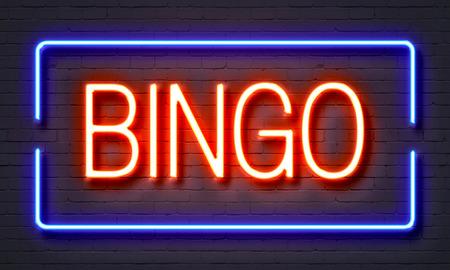 Bingo letrero de neón en el fondo de pared de ladrillo Foto de archivo