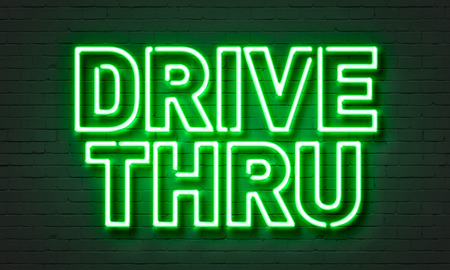 drive through: Drive thru neon sign on brick wall background Stock Photo