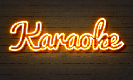 Karaoke neon sign on brick wall background