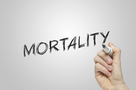 mortality: Hand writing mortality on grey background Stock Photo