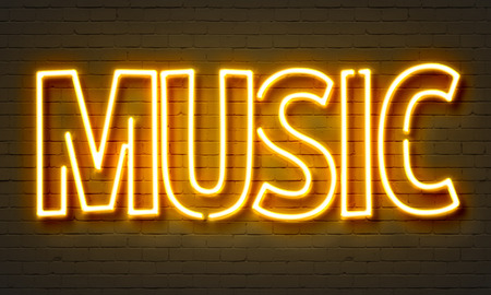 Live music neon sign on brick wall background photo