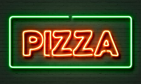 Pizza neon sign on brick wall background photo