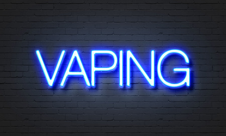 healthier: Vaping neon sign on brick wall background