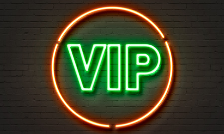vip: VIP longue neon sign on brick wall background