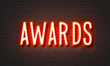 Awards neon sign on brick wall background photo