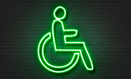 wheelchair access: Disabled friendly neon sign on brick wall background