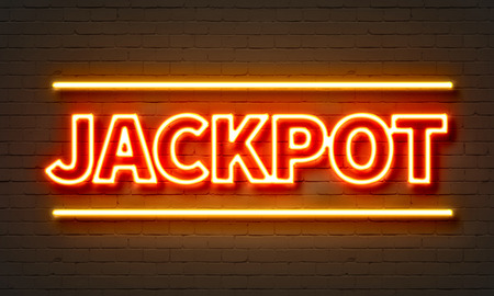 Jackpot neon sign on brick wall background