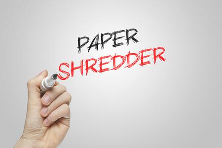 paper shredder: Hand writing paper shredder on grey background Stock Photo