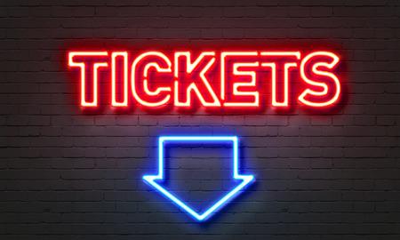 Tickets neon sign on brick wall background Foto de archivo