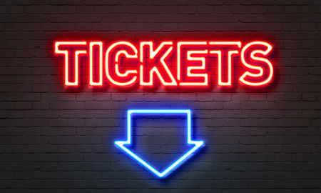 theatre performance: Tickets neon sign on brick wall background Stock Photo