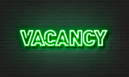 holidays vacancy: Vacancy neon sign on brick wall background