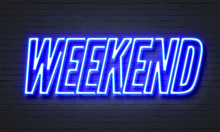 saturday night: Weekend neon sign on brick wall background Stock Photo