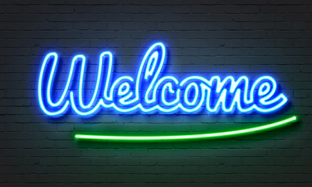 bienvenida: Bienvenido letrero de neón sobre fondo de pared de ladrillo Foto de archivo