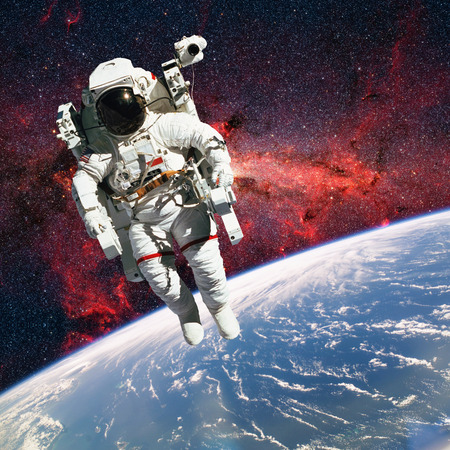 astronaut: Astronaut in outer space with planet earth as backdrop. Elements of this image furnished by NASA.