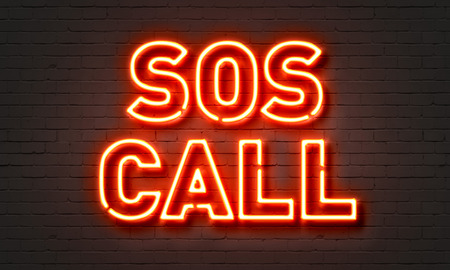 planos electricos: SOS call neon sign on brick wall background