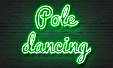 Pole dancing neon sign on brick wall background